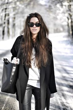 Leather pants, black coat and basic white tee.