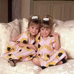 Mary-Kate Olsen[left] and Ashley Olsen[right]  :] so cute