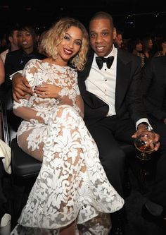 Pin for Later: The Year's Best Award Show Snaps  Jay Z and Beyoncé sat together during the Grammys.