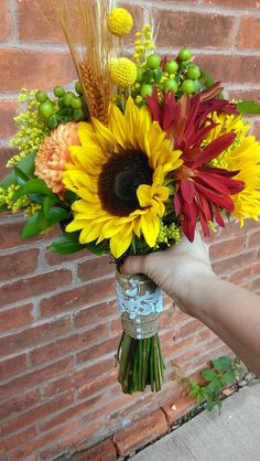 Fall bridal bouquet with sunflowers, rover mum, solidago, dahlia, burlap and lace wrap with grandmothers wedding ring accent