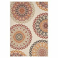 """Stylishly anchor your living room seating group or patio ensemble with this artfully loomed indoor/outdoor rug, showcasing an eye-catching medallion motif  Product: RugConstruction Material: PolypropyleneColor: Cream and redFeatures:  Power-loomed0.25"""" Pile height Note: Please be aware that actual colors may vary from those shown on your screen. Accent rugs may also not show the entire pattern that the corresponding area rugs have.Cleaning and Care: Professional cleaning recommended"""