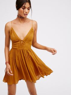 First Love Fit + Flare | Sheer fit and flare dress with crochet accent along bust and back. Thin straps and tie detailing in front and back. Unlined.