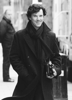 Benedict Cumberbatch: 'Sherlock' Set with Martin Freeman!: Photo Benedict Cumberbatch flashes a grin on the set of his massively popular series Sherlock on Wednesday (April in London, England. The actor was… Benedict Sherlock, Sherlock Fandom, Sherlock Coat, Sherlock Cumberbatch, Sherlock Quotes, Watch Sherlock, Sherlock Series, Doctor Strange, Baker Street
