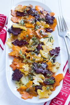 Root veggies with maple-caper dressing. Beets, butternut squash, and yukon gold potatoes.