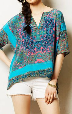 I know yours is a different pattern but this is the closest I can find in a quick search.   Anthropologie  Frida Poncho Blouse
