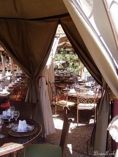 The large tent at Moyo Spier. Traditional South African (the emphasis being on African) food is served. Live music and entertainment, and face painting. Places To See, Places Ive Been, Wooden Bar Table, South Afrika, Hidden House, Africa Destinations, Paradise On Earth, Game Reserve, Bars For Home