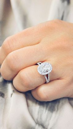 This elegant split diamond band engagement ring successfully highlights the oval diamond halo with a 2.52 carat Oval Cut by Ascot Diamonds