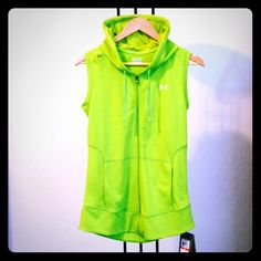 """Under Armour long hoodie vest XS Under Armour Catalyst Heatgear jersey neon green hooded vest. 100% polyester, key pocket near right shoulder, 2 front kangaroo pockets. 17"""" armpit to armpit, 26"""" length from back of neck to bottom. Great for running, going to gym, wearing with leggings. Brand new with tags. Under Armour Tops Sweatshirts & Hoodies"""
