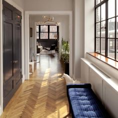 Above: The architects replaced sliding picture windows with casement windows to emulate industrial loft spaces in the entry hall of the first level of the ...