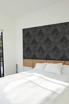 A much cooler (and sleeker) headboard idea than the framed fabric I'm using now. Removable, too. $39.00