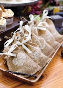 Rustic and natural, these burlap favor bags are filled with vintage charm. #davidsbridal #rusticwedding #weddingfavors