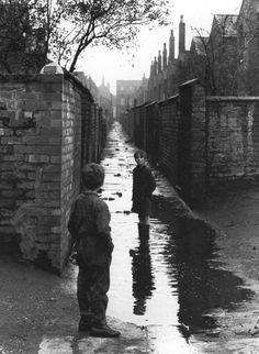 Photographer Shirley Baker, Playing in puddles, Manchester, 1966 #womensart