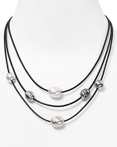 """Softly glowing manmade pearls stylishly punctuate this triple-strand leather necklace from Majorica.   16""""L to 18""""L   Sterling silver/leather/Manmade Pearls. Imported   Photo may have been enlarged an"""
