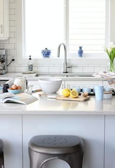 Check out this classic white kitchen renovation with complete list of finishes and sources. The added details make the IKEA kitchen cabinets look custom! More at SatoriDesignforLi. Cheap Rustic Decor, Cheap Home Decor, Home Decor Kitchen, Diy Kitchen, Kitchen Ideas, Space Kitchen, Kitchen Hacks, Kitchen Sink, Kitchen Interior