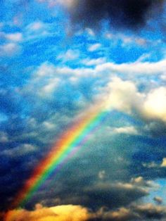 Rainbow through blue skies