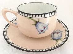 Pretty in pink porcelain teacup and saucer, this RS Germany set with white flowers and red centers is absolutely stunning. The black and white edging along the border of both teacup and saucer finish this gorgeous Art Deco style set. RS Germany is part of the wording in marks used by the