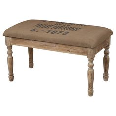 Upholstered bench with a typographic motif and wood frame.