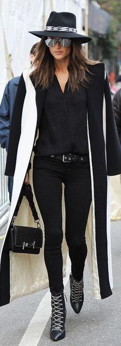 Who made  Alessandra Ambrosio's hat, black skinny jeans, aviator sunglasses, belt, chain boots, handbag, and skinny jeans?