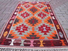 Check out this item in my Etsy shop https://www.etsy.com/listing/516835104/colorful-handmade-vintage-turkish-kilim
