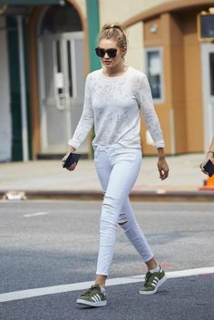 d6f686eb169d Gigi Hadid simple ripped jeans style with green sneakers.