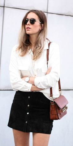 Black suede skirts look just incredible with a white blouse! Via moderosa Skirt: Zara, Shirt: Mango