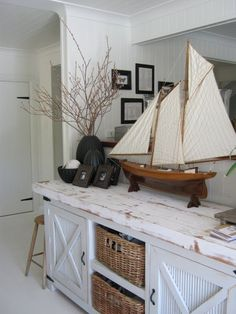Fantastic coastal/ farmhouse charm. Beadboard with added cross pieces, basket storage and a wonderful distressed wood countertop.