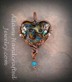 Lampwork Multi-color Foil glass Heart Shaped Pendant Wire-wrapped in Copper Patina with Czech glass beads and Aqua blue Swarovski crystal.
