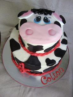 Buttercream cake with fondant accents and hand painted cow face.  I love him...