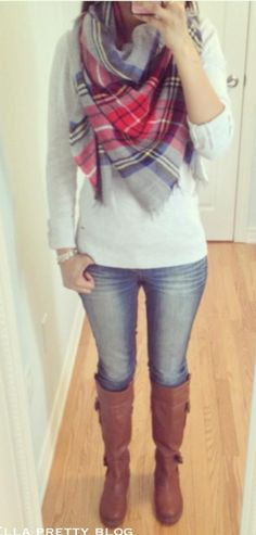 Cream sweater, plaid scarf, jeans, brown riding boots