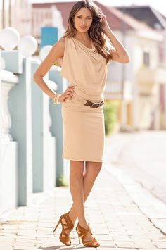 Sexy belted drape dress with gathered detail in an easy pull-on style. Fully lined.