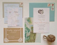 nautical wedding invitation with coastal map and oyster