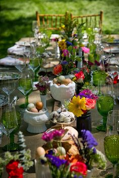 A farm-to-table concept with a posh place setting: Sevres China, Vintage Green Carnival Glassware, Pure Wine Stemware, Milk Glass Centerpieces Dinner in the field by Experimental Field (Lucas, Texas). Tabletop by POSH Couture Rentals