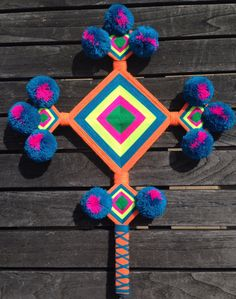 The Ojo de Dios or God's eye is a ritual tool, magical object, and cultural symbol evoking the weaving motif and its spiritual associations for the Huichol and Tepehuan Indians of western Mexico. The