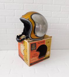 Vintage Seaway Helmet  Gold metallic with Silver metallic circles.  Comes in the original box.  The