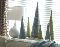 Sweater tree - a cute way to use leftover sweaters after making pillows and leg warmers!
