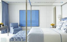 Contemporary Style bedroom in a serene White walls decorative accessories and art  in a bright Cornflower Blue