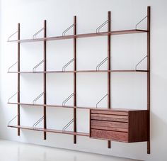 Beautiful reproductions of Cadovius' 1948 Royal System modular shelving are now available. We take a close look at this classic midcentury modern shelving -- being made again today in Denmark -- and for sale in the U. at Design Within Reach. Track Shelving, Wall Shelving Units, Office Shelving, Shelving Design, Modular Shelving, Wood Wall Shelf, Shelving Systems, Modern Shelving, Wall Mounted Shelves