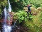 Canyoning in Madeira. Island of the coast of Africa owned by Portugal called the land of eternal spring. It is gorgeous and this was an amazing experience. You get to see everything off the beaten path. Could have done without the embarrassing wetsuit!!! although this pic isn't me! :)