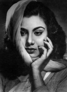 An autographed portrait of the actress Nimmi (b. 1933, real name: Nawab Banoo),. Nimmi was seen in several successful films of the 1950s and 60s including Barsaat (1949), Badi Bahu (1951), Alif Laila (1953) and Uran Khatola (1955) among others.