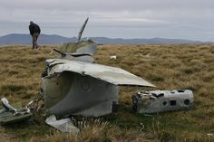 There may not be much left, but its distinctive tail section and grey-green camouflage scheme identify this downed British aircraft as an RAF Harrier GR3, destroyed during the Falklands War in a raid on Goose Green.