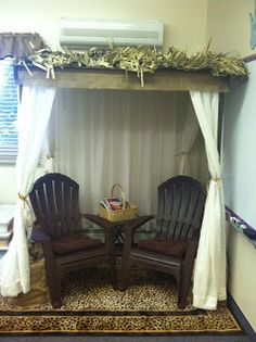 My African themed classroom complete with reading hut, safari chair, and cheetah print seat back covers.  www.lynchwps.blogspot.com