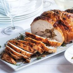 """ROASTED TURKEY ROULADE Garten's genius spin on a traditional roast turkey resolves the challenge of not overcooking the meat to make sure the stuffing is thoroughly heated—her way, both cook evenly. """"Plus, everyone asks for white meat, and my version consists of a whole butterflied breast."""""""