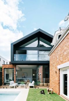 extending up and out has resulted in a large living space and a better link to the garden and separate studio apartment. A deck flows between the dwellings.The red brick facade is complemented by the modern extension. Source by insideoutpins Modern Brick House, Modern House Facades, Modern House Design, Modern Architecture, Red Brick Exteriors, Brick Facade, Facade House, Facade Design, Exterior Design