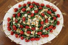 Caprese Skewers - - Well I guess this week was the week of Caprese! I had a fundraiser event yesterday afternoon for our Medical Auxiliary group and was asked to bring a yummy appetizer for women, so I made Capres…. Appetizers For A Crowd, Food For A Crowd, Yummy Appetizers, Appetizer Recipes, Mexican Appetizers, Wedding Appetizers, Caprese Skewers, Wedding Reception Food, Wedding Catering