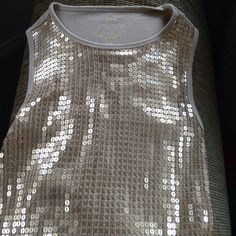 Michael Kors gold sequined tank top Super comfortable, and very eye-catching! The front is covered in gold sequins and the back is a nice soft ribbed Tank. All sequins are still attached and unbroken. MICHAEL Michael Kors Tops Tank Tops