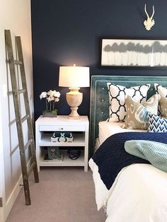 Get inspiration for adding a dark and sophisticated indigo to your home. This daring color goes well with a variety of colors, including white. See how we used indigo as an accent wall, for decor and for wall color. You'll definitely want to go paint your walls indigo after this!