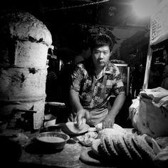'Bread man, oven baked to order bread - night - Shangqiu, Henan, China', by Mark Hobbs, 2012