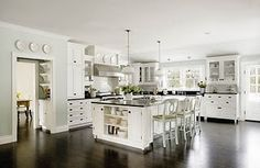 I love how light and airy this kitchen is, and I LOVE the dark floor.