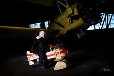 I took this of my daughter at the WWII hangar that we store our airplane in. Jane has her own little biplane to ride on. She's wearing her flight jacket as well.