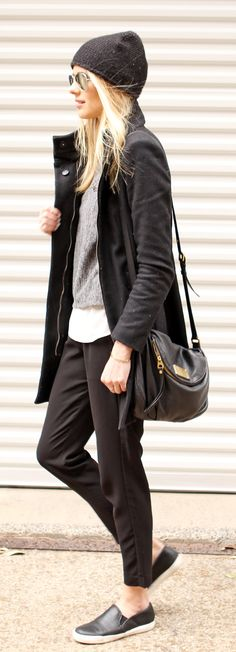 Amy Jackson is wearing a black jacket and beanie from Zara, grey top from Goodnight Macaroon, black trousers from H&M and the black slip-ons are from Steve Madden